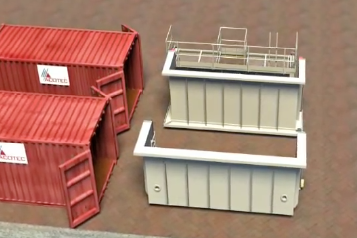 An image of two big containers with two pieces of unassembled devices.